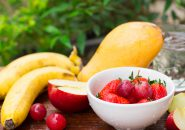 Fresh fruit mix and water for healthy, strawberry, grape, orange, banana and mango